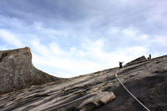 Mount Kinabalu summit with hikers in silhouette Royalty Free Stock Image