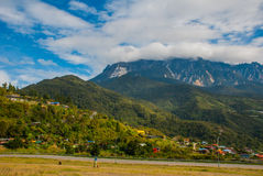 Mount Kinabalu view, villages at the foothill of the mountain. Sabah, Borneo, Malaysia Royalty Free Stock Images