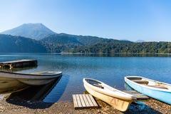 Mount Kirishima and boat Royalty Free Stock Images