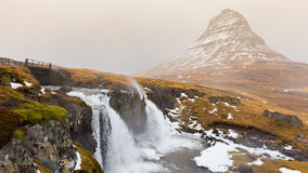 Mount Kirkjufell volcano with small waterfall in cloudy and rainy day, Stock Image