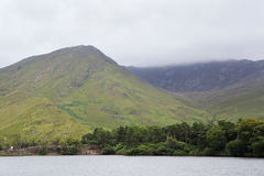 Mount and lake near the Kylemore Abbey. Royalty Free Stock Photo