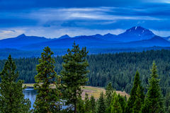 Mount Lassen and Brokeoff Mountain overcast morning. A blue overcast sunrise over the mountains of this California National Park, with Lake Almanor in the Stock Image