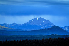Mount Lassen overcast morning. Sunrise barely touches the peak of Mount Lassen at this National Park in California on this unusually overcast morning Royalty Free Stock Images