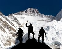Mount Lhotse and silhouette of group of climbers Royalty Free Stock Photography