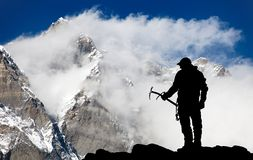 Mount Lhotse and silhouette of man with ice axe Royalty Free Stock Photo