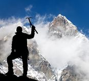 Mount Lhotse and silhouette of man wirh ice axe Stock Image