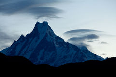 """Mount Machapuchare Or Fish Tail at sunrise Himalaya Mountains. This majestic peak in the Himalayas is called Machapuchare, also known as """"Fish Tail Mountain Royalty Free Stock Image"""