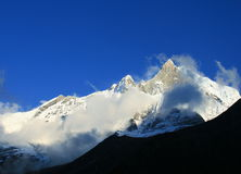 Mount Machhapuchhare, the fish tail, in evening clouds, Pokhara, Nepal.  Royalty Free Stock Images