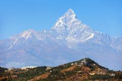 Mount Machhapuchhre, Annapurna area, Nepal himalayas. Blue colored view of mount Machhapuchhre, Annapurna area, Nepal himalayas mountains stock photos