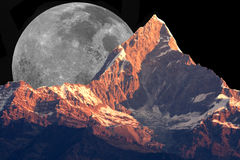 Mount Machhapuchhre and the Moon Stock Photo