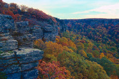 Mount Magazine in fall color. The bluffs of Magazine mountain rising over colorful autumn trees stock photography
