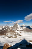 Mount Matterhorn covered with clouds on a clear day after snow fall in autumn Stock Images