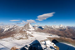 Mount Matterhorn covered with clouds on a clear day after snow fall in autumn royalty free stock photos