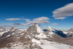 Mount Matterhorn covered with clouds on a clear day after snow fall in autumn,  Valais Royalty Free Stock Photography