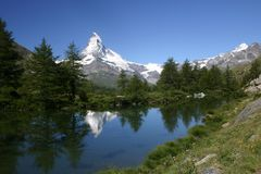 Mount Matterhorn reflects. In a wooded mountain lake Stock Image