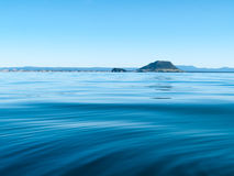 Mount Maunganui across blue ocean. Royalty Free Stock Images