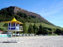 Mount Maunganui Lifeguard. Surf Life Saver Station on Maunganui Beach - Mount Maunganui in the background, Bay of Plenty, New Zealand Royalty Free Stock Image