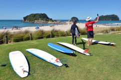 Mount Maunganui - New Zealand. MOUNT MAUNGANUI, NZL - JAN 18 2015:Surfing lession in Papamoa beach reserve in Mount Maunganui. It's a very popular travel royalty free stock image