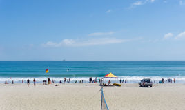 Mount Maunganui ocean beach with people enjoying summer and beach activities. Mount Maunganui, New Zealand - December 21, 2016; Mount Maunganui ocean beach with stock images