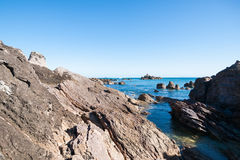 Mount Maunganui, rocky coastline at foot of mount Stock Image