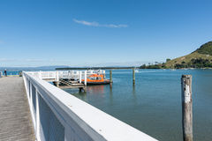 Mount Maunganui Salisbury Wharf with orange water taxi at pier a Stock Photography