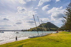 Mount Maunganui, Tauranga New Zealand. Tauranga, New Zealand - November 20, 2014: Mount Maunganui is extinct volcano that rises above the town of Tauranga. It is royalty free stock photo