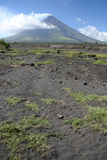 Mount mayon volcano landscape luzon philippines. Lava and ash in the debris field in front of Symmetrical cone of mount mayon and active volcano in albay stock photo