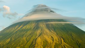 Mount Mayon Volcano in the province of Bicol, Philippines. Clouds Timelapse. Mount Mayon Volcano in the province of Bicol, Philippines. Clouds Timelapse royalty free stock photos