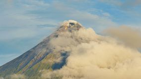 Mount Mayon Volcano in the province of Bicol, Philippines. Clouds Timelapse. Mount Mayon Volcano in the province of Bicol, Philippines. Clouds Timelapse royalty free stock images