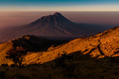 Mount Merbabu in darkness. Photo of Mt. Merbabu in darkkness of morning near Yogya in central Java province in Indonesia. In this region, one can only meet Stock Photo