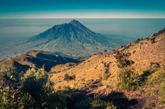 Mount Merbabu in morning. Photo of Mt. Merbabu in morning near Yogya in central Java province in Indonesia. This is very remote location, rarely visited by Stock Photography