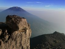 Mount Merbabu seen from Mount Merapi, Central Java, Indonesia. Mount Merapi seen from Yogyakarta, Java, Indonesia. Is one of the most active mountains in the royalty free stock photography