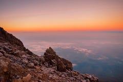 Mount Meru sunrise. Sunrise above the clouds at Mount Meru, Arusha National Park royalty free stock photo