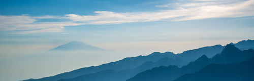 Mount Meru view from Kilimanjaro Machame route. Trail Royalty Free Stock Photo