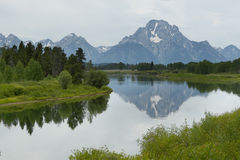 Mount Moran reflected in the Snake river Stock Image