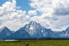 Mount Moran Teton Range. Mount Moran stands majestically as a hawk soars by Stock Photo