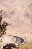 Mount Nebo, road, Jordan, Middle East, desert, landscape, climate change. Jordan 05/10/2013: Jordanian and desert landscape with the winding road to Mount Nebo Royalty Free Stock Photography