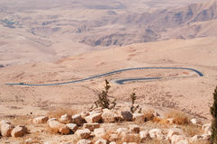 Mount Nebo, road, Jordan, Middle East, desert, landscape, climate change. Jordan 05/10/2013: Jordanian and desert landscape with the winding road to Mount Nebo Stock Photo