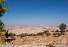 Mount Nebo, road, Jordan, Middle East, desert, landscape, climate change. Jordan 05/10/2013: Jordanian and desert landscape with the winding road to Mount Nebo Royalty Free Stock Image