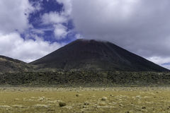 Mount Ngauruhoe New Zealand. A low angle view of Mount Ngauruhoe from the south crater at the Tongariro Alpine Crossing in New Zealand Royalty Free Stock Image