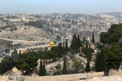 Mount of Olives with Dominus Flevit Roman Catholic church. And Russian Orthodox Church of Mary Magdalene against the background of Bab Al-Rahmah Muslim Cemetery Royalty Free Stock Images