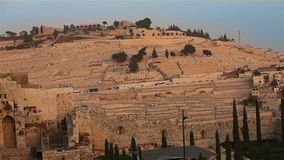 The Mount of Olives overlooking the cemetery towards the Dome of the Rock at sunset. stock video footage