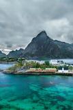 Mount Olstind above the  Sakrisoy fishing village, Lofoten Royalty Free Stock Photo