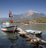 Mount Olympos, Antalya, Turkey. View of boats on small jetty off Phasaelis, Antalya Turkey, with Mount Olympos in the background Royalty Free Stock Photo