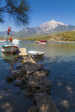 Mount Olympos, Antalya, Turkey. View of boats on small jetty off Phasaelis, Antalya Turkey, with Mount Olympos in the background Stock Images