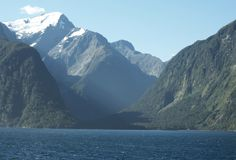 Mount Pembroke. Rising up from the great Milford sound in New Zealand's fiordland is the great mount Pembroke. It stands at 2014m, so is covered with snow Stock Photography