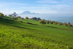 Mount Pilatus and Lake Lucerne covered with frog, Alps Royalty Free Stock Photo