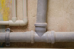 Mount pipe on wall Stock Photography