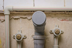 Mount pipe on wall Stock Images