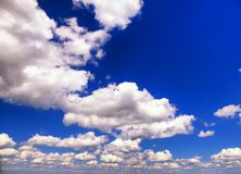 Mount Race white clouds and blue sky Royalty Free Stock Photos